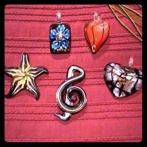 Five glass pendants
